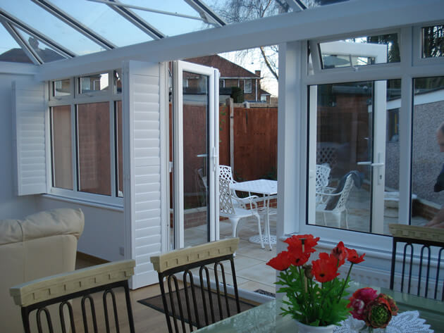 open conservatory shutters in summer