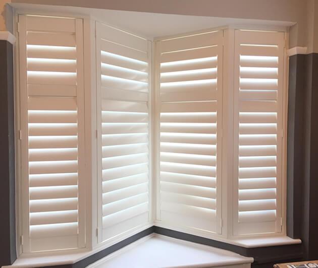 silent tilt rod system on angled shutters