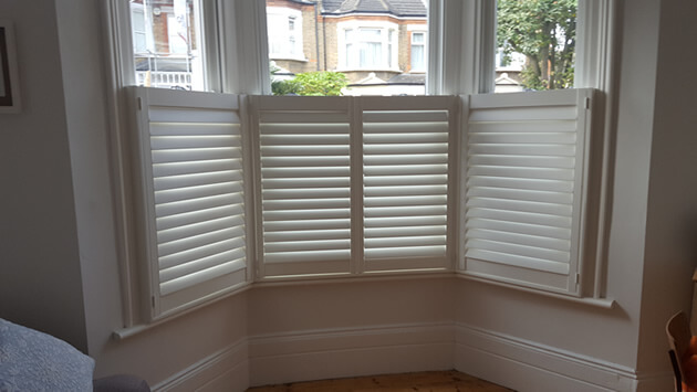 Cafe style shutters for bay window in elmers end, kent | shuttersup.