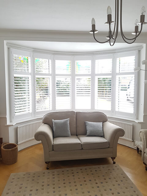 white bay window shutters