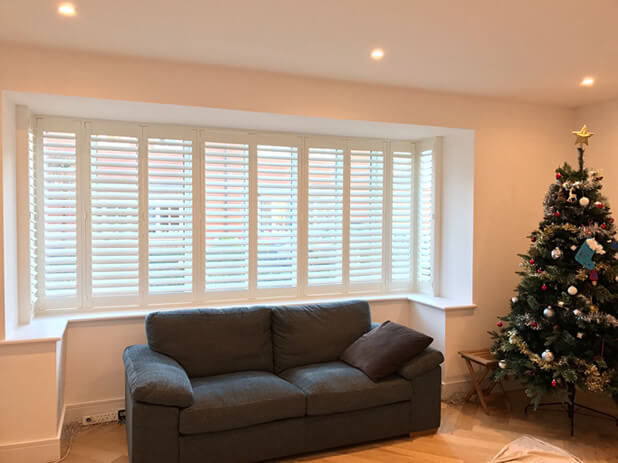 square bay window lounge shutters