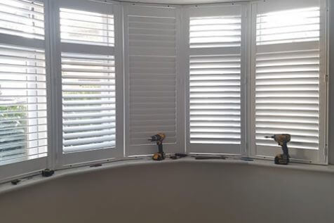 Living Room Bay Window Shutters for Home in Bromley, Kent