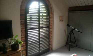 Custom Larchwood Arch Shutters for Home in Tunbridge Wells, Kent