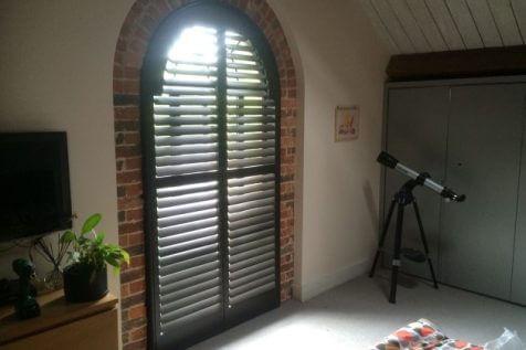 Custom Larchwood Arch Shutters for Home in Tunbridge Wells, Kent