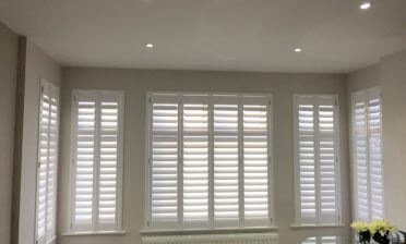 Full Height Bali Shutters for multiple windows of Home in Banstead, Surrey