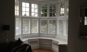 Living Room Bay Window Shutters in Thames Ditton, London