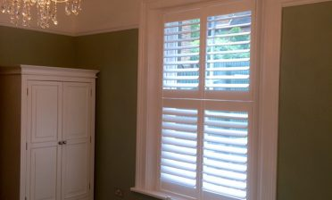 Pure White Tier on Tier Shutters for Bedroom in Caterham, Surrey