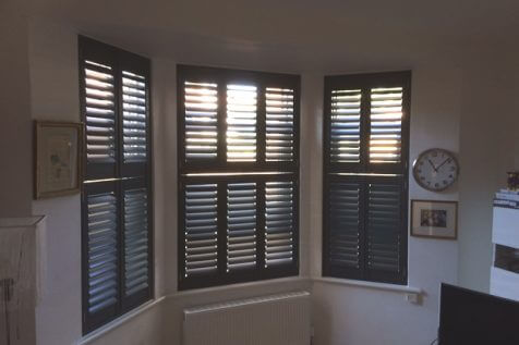 Tier on Tier Bi-Folding Shutters for Living Room in Brighton