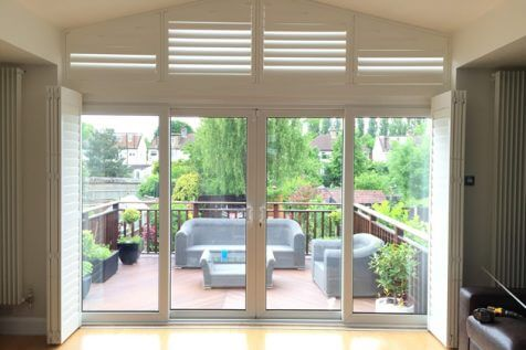 Track System Shutters with special shape above installed for Home in Bromley, Kent