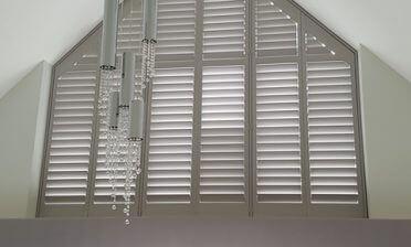 Special Shape Shutters for Large Window in Property in Oxshott, Surrey