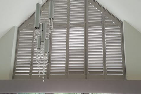 Special Shape Shutters for Large Window in Property in Oxshott, Surrey