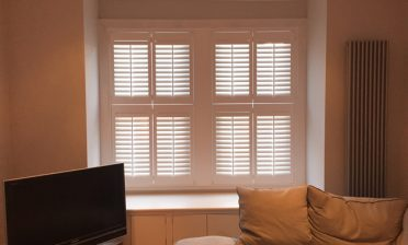 Tier on Tier Shutters for living room of Home in Downe, Kent