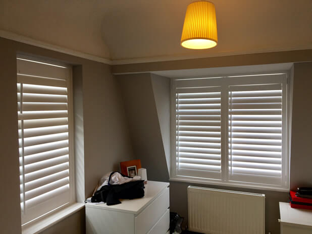 two windows with full height shutters