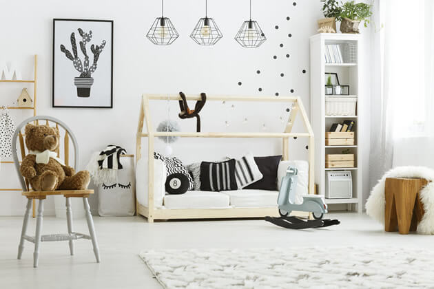 childs room with house bed