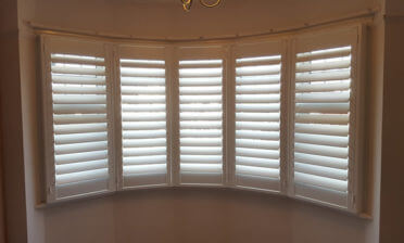 Bedroom Bay Window Shutters for Home in Chigwell, Essex