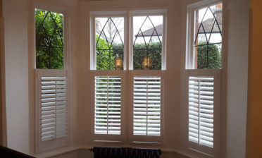Bay window café style shutters for property in Tilbury