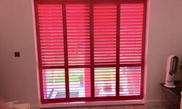 Red Custom Colour Shutters for Kitchen and Patio Doors of Home in Essex