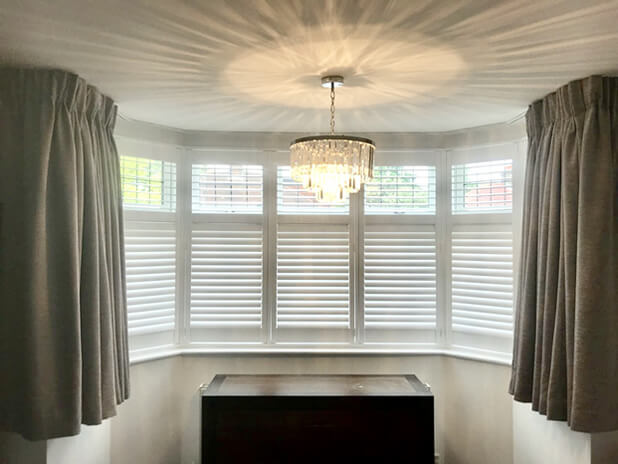bay window shutters with curtains dulwich