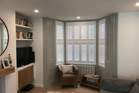 Traditional Bay Window Shutters for Living Room of Home in Essex