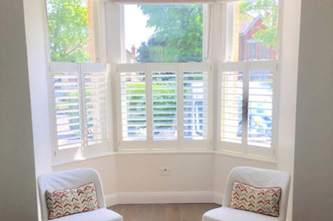 Café Style Bay Window Shutters for Living Room of Home in Beckenham, Kent