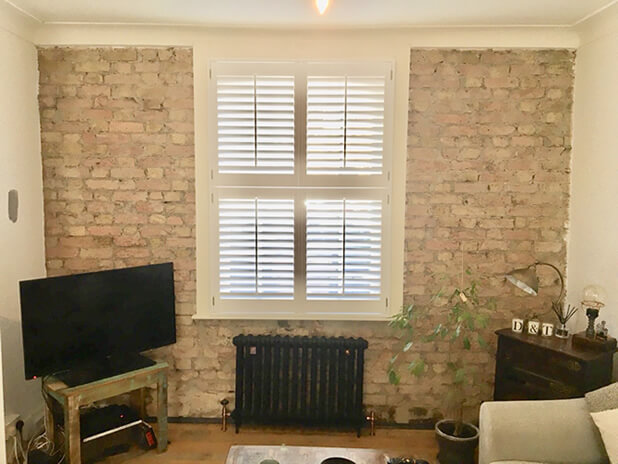 exposed brick work living room shutters