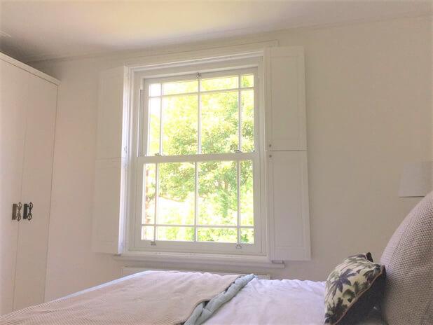 solid tier on tier shutters bromley bedroom open
