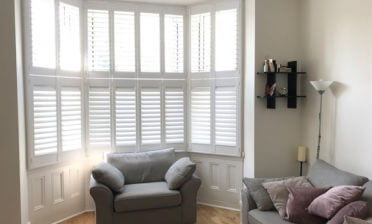 Tier on Tier Shutters for Living Room Bay Window of Home in Belmont, Surrey