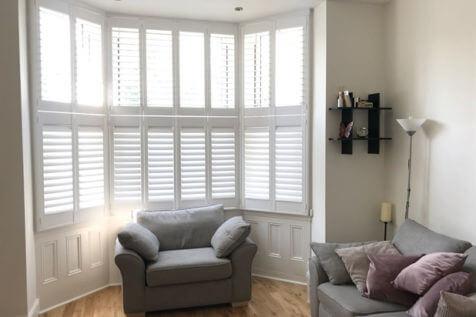 Tier on Tier Shutters for Living Room Bay Window of Home in Belmont, Surrey