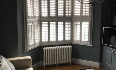 Bay Window Tier on Tier Shutters for Property in Hampstead, London