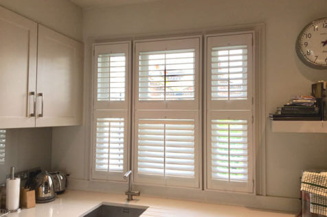 PVC Tier on Tier Shutters for Kitchen of Home in Epsom, Surrey