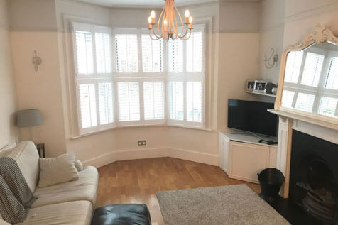 Tier on Tier Shutters for Living Room of Home in Warlingham, Surrey