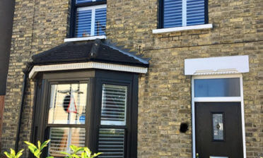 Pure White Tier on Tier Shutters against Black Sash Window Frames in Gravesend, Kent