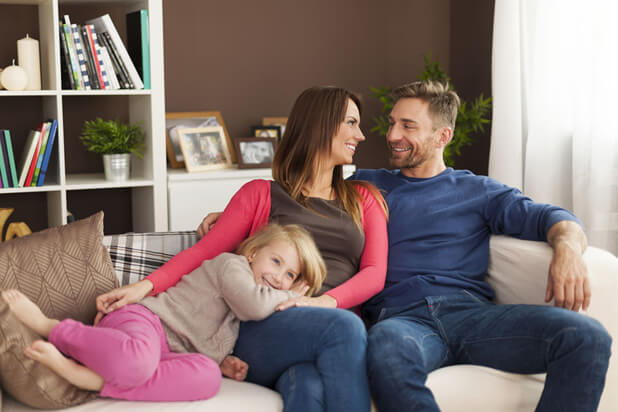 family on living room sofa