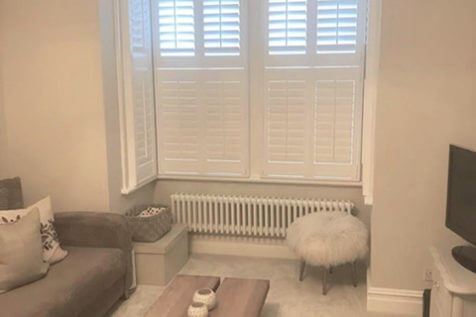 Tier on Tier Shutters for Living Room Bay Window in Guildford, Surrey