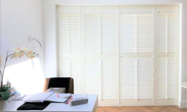 Paulownia Patio Door Shutters for Property in Bromley, Kent