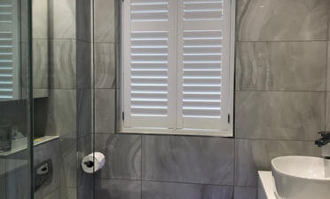 Full Height Java Shutters for Luxury Bathroom in Dorking, Surrey