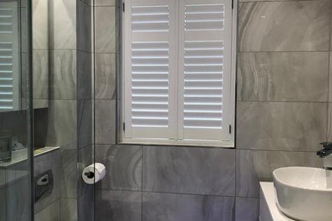 Full Height Java Shutters for Luxury Bathroom in Dorking, Surrey