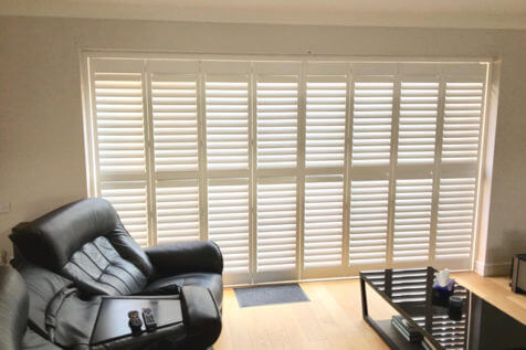 Bi-Folding Track Shutters for Patio Doors of Property in Chertsey, Surrey