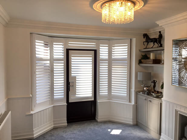 Shutters for French door and Bay Window area of Living Room in Horsham, Sussex